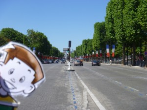 Flat Stanley looking down the Avenue des Champs-Élysées toward the Arc de Triomphe