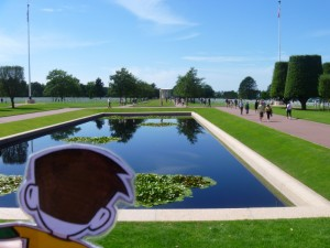 Flat Stanley looking at the American cemetery in Normandy